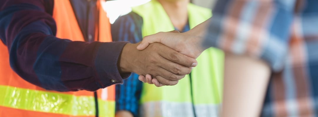 client and contractor shaking hands